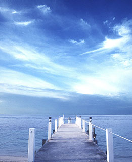 View of jetty in blue sea