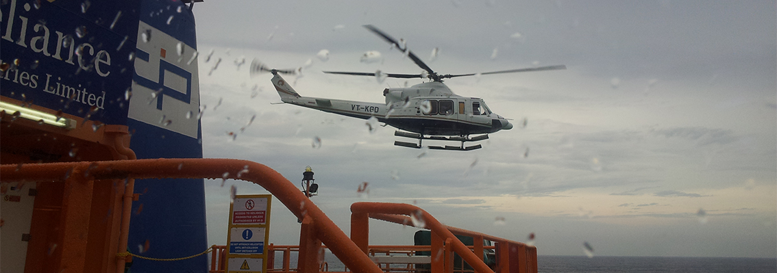 Helicopter landing on location offshore in stormy weather
